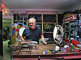 John Hayward in his Austin neon shop.